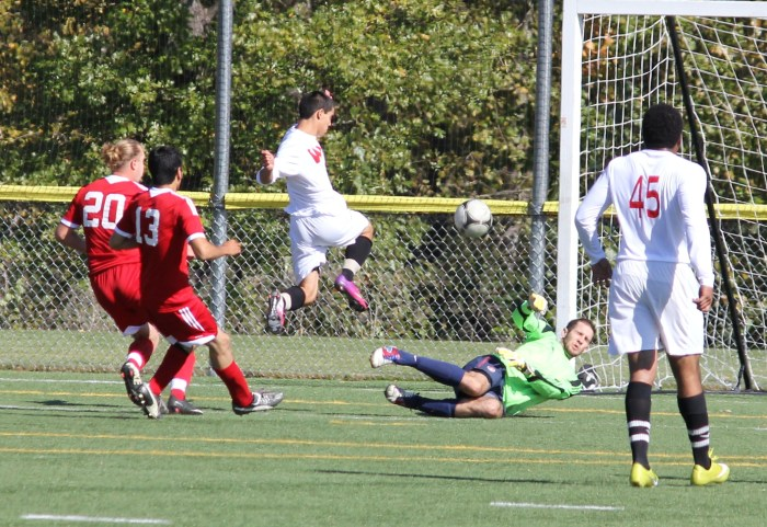 Club captain Josh Hill makes a save in the first half of a 4-0 win vs. Western Oregon University. Evan Ream/findingxavi.com